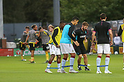 The two teams warm up during the second round or the Carabao EFL Cup match between Burton Albion and Aston Villa at the Pirelli Stadium, Burton upon Trent, England on 28 August 2018.
