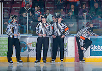 KELOWNA, CANADA - NOVEMBER 23:  Mike Langin and Ward Pateman, linesmen and Jeff Ingram and Matt Thurston, referees, stand on the ice at the start of the game of the Regina Pats at the Kelowna Rockets on November 23, 2012 at Prospera Place in Kelowna, British Columbia, Canada (Photo by Marissa Baecker/Shoot the Breeze) *** Local Caption ***