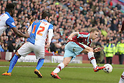 Burnley midfielder Scott Arfield  goes away from Blackburn Rovers forward on loan from Sunderland, Danny Graham (12)   during the Sky Bet Championship match between Burnley and Blackburn Rovers at Turf Moor, Burnley, England on 5 March 2016. Photo by Simon Davies.
