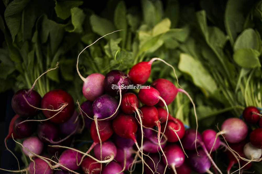 Organic easter egg radishes from Kirsop Farm in Tumwater on opening day of the Columbia City Neighborhood Farmer's Market. (Bettina Hansen / The Seattle Times)