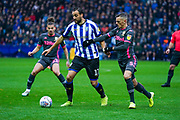 Leeds United defender Ben White (5) and Sheffield Wednesday forward Atdhe Nuhiu (17) during the EFL Sky Bet Championship match between Sheffield Wednesday and Leeds United at Hillsborough, Sheffield, England on 26 October 2019.