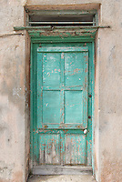 Square green door in Menton, France