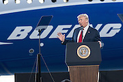 U.S. President Donald Trump address employees at the debut of the new Boeing 787-10 Dreamliner aircraft at the Boeing factory February 17, 2016 in North Charleston, SC. The visit comes two days after workers at the South Carolina plant voted to reject union representation in a state where Trump won handily.