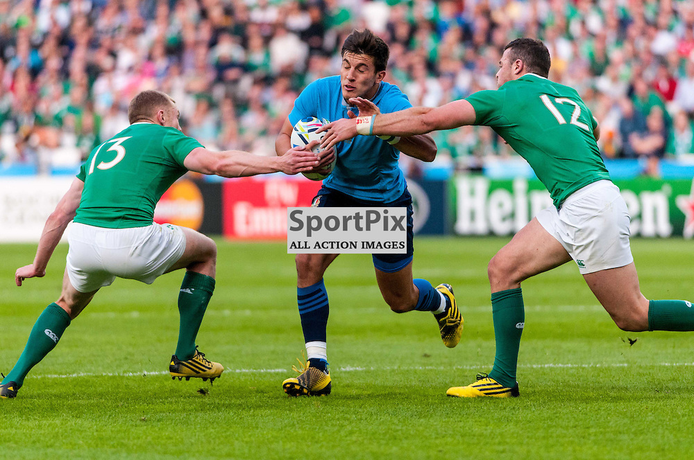 Tommaso Allan of Italy is tackled by Robbie Henshaw and Keith Earls of Ireland. Action from the Ireland v Italy pool game at the 2015 Rugby World Cup at Queen Elizabeth Stadium in London, 4 October 2015. (c) Paul J Roberts / Sportpix.org.uk
