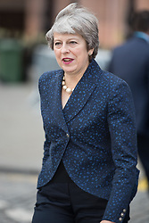 © Licensed to London News Pictures . 02/10/2017. Manchester, UK. Prime Minister THERESA MAY leaves the Midland Hotel at the start of the second day of the Conservative Party Conference at the Manchester Central Convention Centre . Photo credit: Joel Goodman/LNP