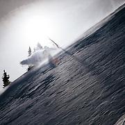 Angel Collinson makes high speed powder turns in the Teton backcountry near Jackson Hole Mountain Resort.