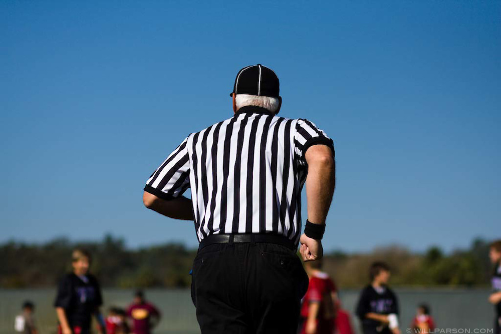 A referee for the game between Rock Academy and Calvary Christian Academy runs onto the field during the Spirit Bowl Flag Football tournament hosted by Horizon Prep Academy on October 24, 2008 in Rancho Santa Fe.