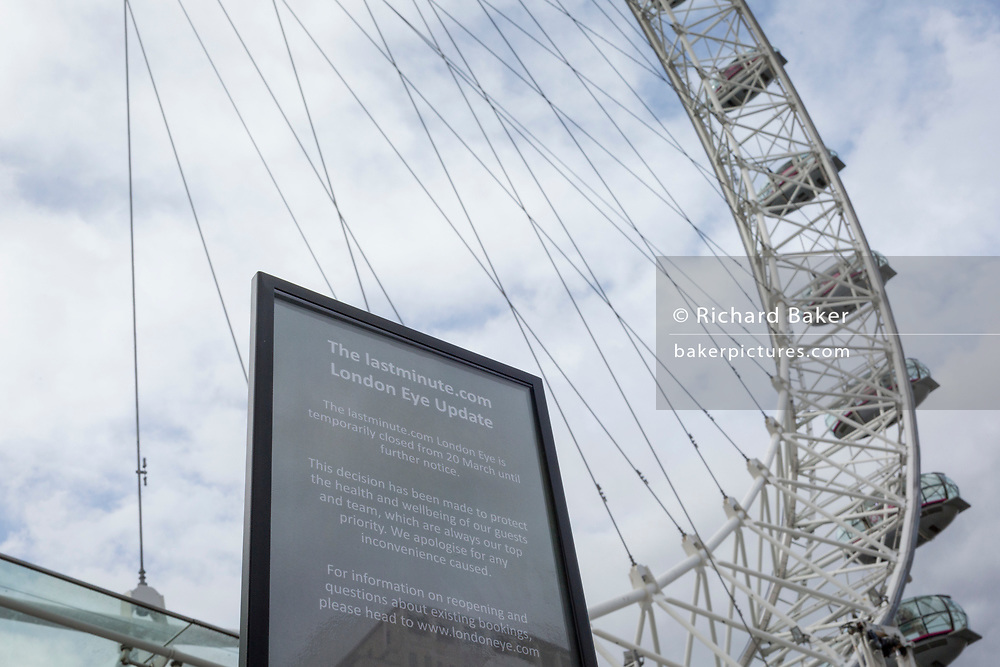 As the UK government announces further Coronavirus-related restrictions to its citizens, with the immediate closure of pubs, cafes, gyms and cinemas, and the worldwide number of deaths reaching 10,000 with 240,000 cases, 953 of those in London alone, a notice alerts visitors of the London Eye closure, on 20th March 2020, in London, England.