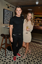 SCOTT ASHLEY and LAURA ELLIOTT at Henry Conway's 31st birthday party held at the Pont St Restaurant, Belgraves Hotel, London on 12th July 2014.