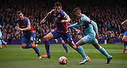 Scott Dann tracks Dimitri Payet as he breaks for West Ham during the Barclays Premier League match between Crystal Palace and West Ham United at Selhurst Park, London, England on 17 October 2015. Photo by Michael Hulf.
