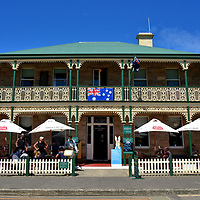 Richmond Arms Hotel in Richmond, Australia<br /> This façade immediately grabs your attention while walking along Bridge Street. In Australia, it is referred to as a terrace house, a popular design in the country's inner cities during the 19th century. The elaborate, cast iron ornamentation is called the Filigree style. The Lennox Arms Hotel operated on this site from 1827 until it burned in 1888. The Commercial Hotel replaced it and was renamed the Richmond Arms Hotel in 1972. Their outdoor seating is a popular way to enjoy its bistro food and a local wine during a lovely afternoon.