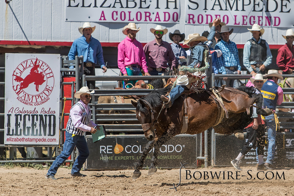 Saddle bronc rider Carter Elshere rides Summit Pro Rodeo's 75 Black Magic in the first performance of the Elizabeth Stampede on Saturday, June 2, 2018.