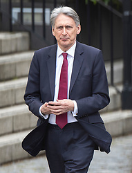 © Licensed to London News Pictures. 03/04/2019. London, UK. Chancellor Philip Hammond walks from the House of Commons after Prime Minister's Questions. Prime Minister Theresa May has called for talks with Labour Party Leader Jeremy Corbyn to seek a way forward with the Brexit deadlock. Photo credit: Peter Macdiarmid/LNP