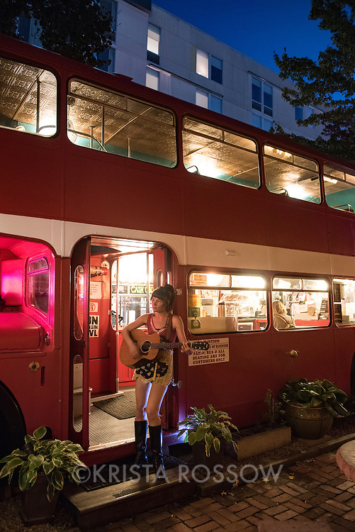 Waitress Laura Boyle works at Double D's and  is also a musician who goes by Lo Wolf. Double D's Coffee and Dessert is a local landmark housed in a red double-decker bus at 41 Biltmore Avenue in Downtown Asheville, North Carolina.