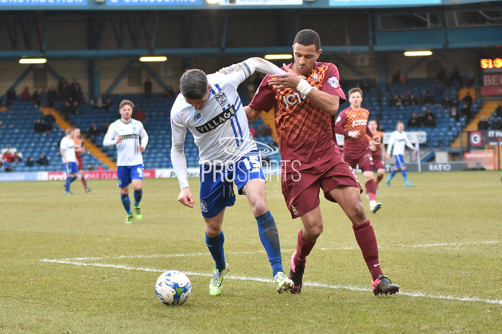 Bury Forward, Ryan Lowe and Bradford City Defender, James Meredith battling during the Sky Bet League 1 match between Bury and Bradford City at the JD Stadium, Bury, England on 5 March 2016. Photo by Mark Pollitt.
