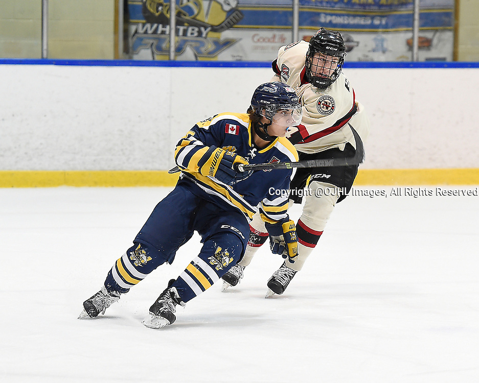 WHITBY, ON - Oct 9, 2015 : Ontario Junior Hockey League game action between Newmarket and Whitby, Steven Elliott #10 of the Whitby Fury and Adam Smith #4 of the Newmarket Hurricanes pursue the play during the second period.<br /> (Photo by Andy Corneau / OJHL Images)