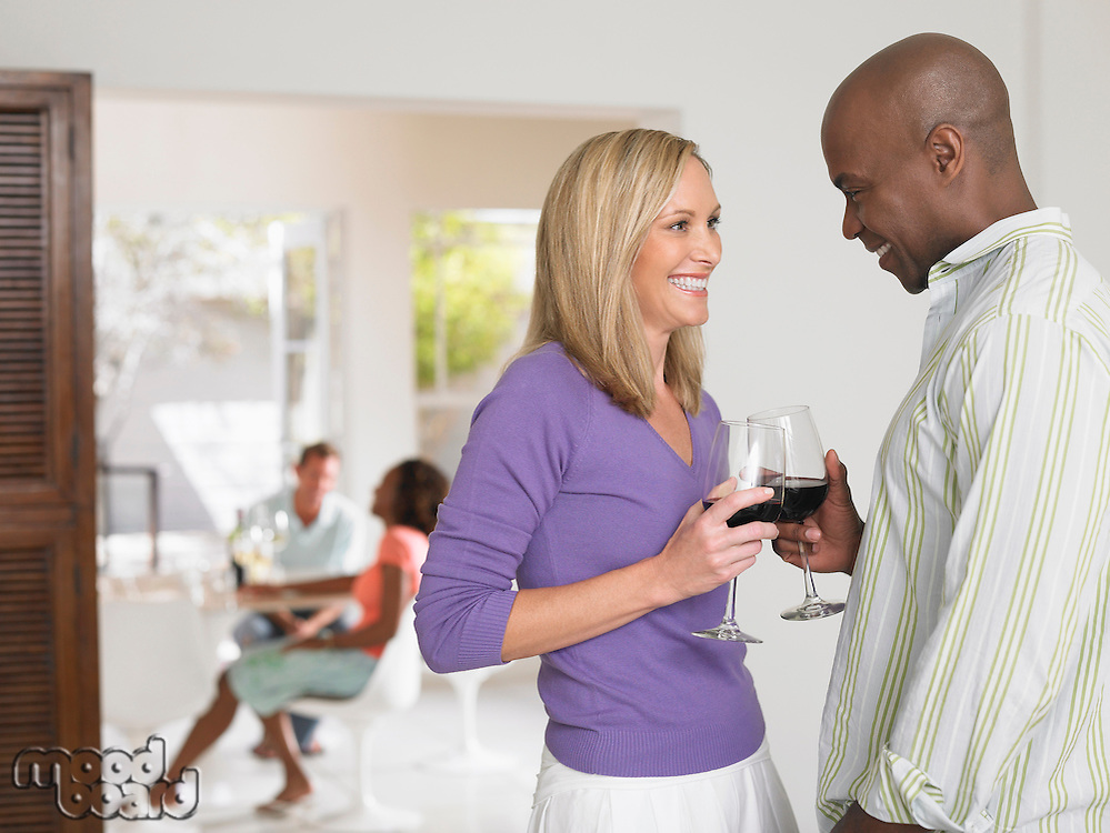 Couple toasting with wineglasses at home