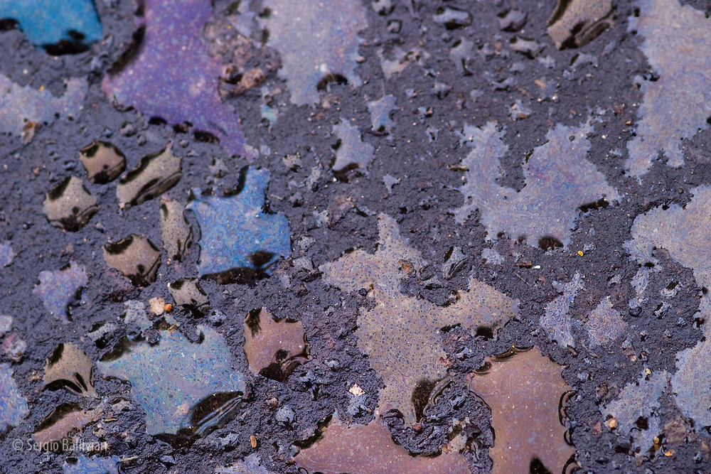 Close-up of an oil spill on a parking lot in Boulder, Colorado