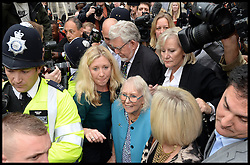 Artist and television personality Rolf Harris leaves with his wife Alwen Hughes The City of Westminster Magistrates Court, London, England. Mr Harris, who was arrested in March by police officers working for Operation Yewtree, has been charged with nine counts of indecent assault on teenage girls and four counts of making indecent images of children, United Kingdom. Monday, 23rd September 2013. Picture by Andrew Parsons / i-Images<br />