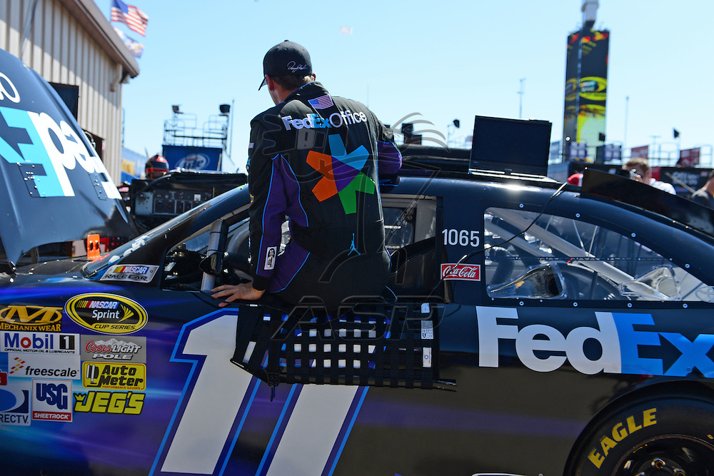 Brooklyn, MI  - Aug 18, 2012: Denny Hamlin (11) gets out of his car during practice for the Pure Michigan 400 at Michigan International Speedway in Brooklyn, MI.