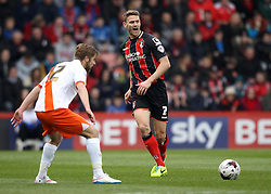 Bournemouth's Simon Francis passes past Blackpool's Michael Jacobs - Photo mandatory by-line: Robbie Stephenson/JMP - Mobile: 07966 386802 - 14/03/2015 - SPORT - Football - Bournemouth - Dean Court - AFC Bournemouth v Blackpool - Sky Bet Championship