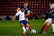 Jay DaSilva England U21s (Bristol City - on loan from Premier League club Chelsea) being put under pressure by Chris Cadden Scotland U21s (Motherwell FC) during the U21 UEFA EUROPEAN CHAMPIONSHIPS match Scotland vs England at Tynecastle Stadium, Edinburgh, Scotland, Tuesday 16 October 2018.