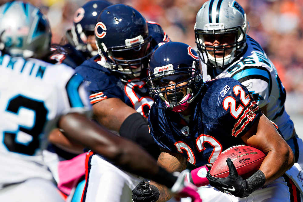 CHICAGO, IL - OCTOBER 2:  Matt Forte #22 of the Chicago Bears runs the ball against the Carolina Panthers at Soldier Field on October 2, 2011 in Chicago, Illinois.  The Bears beat the Panthers 34 to 29.  (Photo by Wesley Hitt/Getty Images) *** Local Caption *** Matt Forte