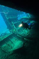 Diver exploring an unidentified wreck, Manokwari, West Papua, Indonesia.