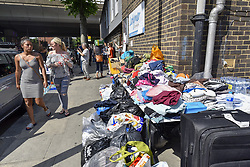 June 14, 2017 - London, UK - London, UK.   Latymer Road Community Church, seen in the foreground, acts as a drop off point for donations of clothing for those displaced by the fire.  The Grenfell Tower near Latimer Road in west London smoulders after it was engulfed in a huge fire the previous night, resulting in at least twelve fatalities with many more in critical condition. (Credit Image: © Stephen Chung/London News Pictures via ZUMA Wire)