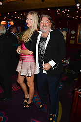 ROBERT TCHENGUIZ and NATALIA PALETSKAIA at a 1970's themed party as part of Annabel's 50th anniversary celebrations, held at Annabel's, Berkeley Square, London on 24th September 2013.