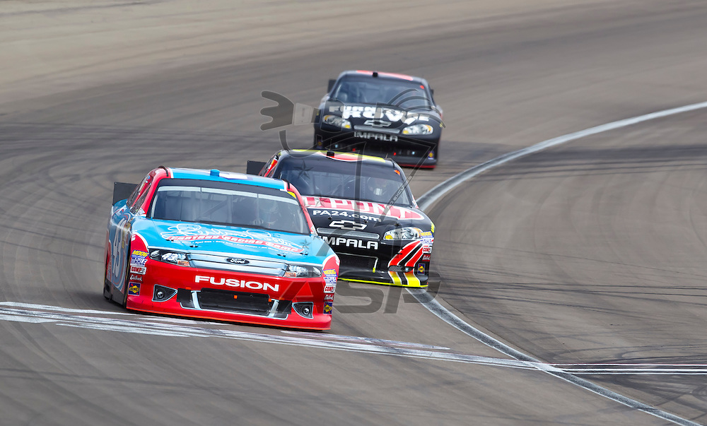 LAS VEGAS, NV - MAR 11, 2012:  Aric Almirola (43) and Jeff Gordon (24) battle for position during the Kobalt Tools 400 race at the Las Vegas Motor Speedway in Las Vegas, NV.