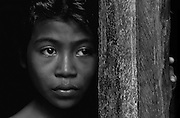 A shy girl watches from a safe place on Lembata Island, Indonesia.