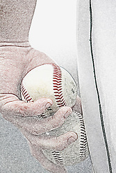 09 June 2011: A player holds 2 baseballs in one hand during a game between the Lake Erie Crushers and the Normal Cornbelters at the Corn Crib in Normal Illinois. This image was produced in part utilizing High Dynamic Range (HDR) or panoramic stitching or other computer software manipulation processes. It should not be used editorially without being listed as an illustration or with a disclaimer. It may or may not be an accurate representation of the scene as originally photographed and the finished image is the creation of the photographer.
