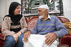 Young woman talking to older man,