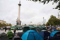 London, UK. 8 October, 2019. Tents pitched by climate activists from Extinction Rebellion blocking Trafalgar Square on the second day of International Rebellion protests to demand a government declaration of a climate and ecological emergency, a commitment to halting biodiversity loss and net zero carbon emissions by 2025 and for the government to create and be led by the decisions of a Citizens' Assembly on climate and ecological justice.