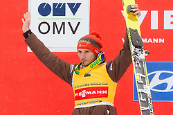Second placed of Overall flying classification Robert Kranjec of Slovenia celebrates during trophy ceremony after the Flying Hill Individual Event at 4th day of FIS Ski Jumping World Cup Finals Planica 2013, on March 24, 2013, in Planica, Slovenia. (Photo by Vid Ponikvar / Sportida.com)