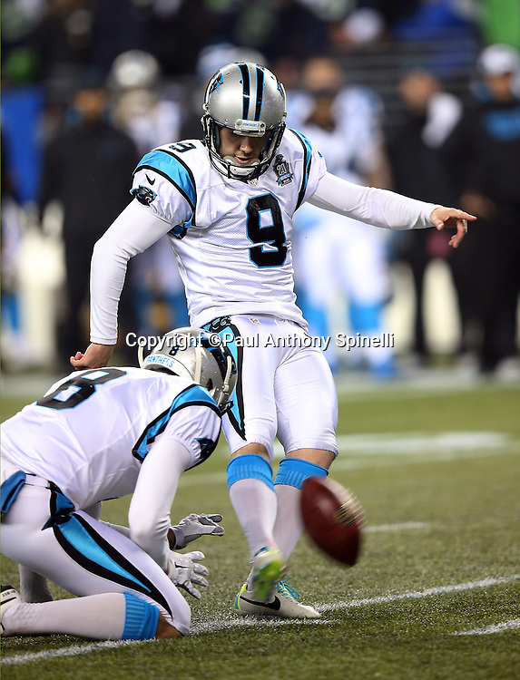 Carolina Panthers punter Brad Nortman (8) holds as Carolina Panthers kicker Graham Gano (9) kicks a late second quarter field goal that cuts the Seattle Seahawks lead to 14-10 during the NFL week 19 NFC Divisional Playoff football game against the Seattle Seahawks on Saturday, Jan. 10, 2015 in Seattle. The Seahawks won the game 31-17. ©Paul Anthony Spinelli