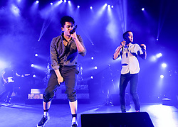 """© Licensed to London News Pictures. 01/03/2014. London, UK.   Rizzle Kicks performing live at Hammersmith Apollo. In this picture - Jordan Stephens (left), Harley Alexander-Sule (right).  Rizzle Kicks are an English hip hop duo from Brighton, consisting of Jordan """"Rizzle"""" Stephens and Harley """"Sylvester"""" Alexander-Sule.   Photo credit : Richard Isaac/LNP"""