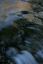 Stock photo of water flowing over rocks in the river in the Texas Hill Country