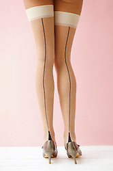 Back View of Woman Wearing Stockings and High Heels, Low Section
