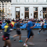 NYTRUN - NOV. 6, 2016 - NEW YORK - Runners pass the Plaza Hotel on Central Park South as they participate in the 2016 TCS New York City Marathon on Sunday afteroon. NYTCREDIT:  Karsten Moran for The New York Times