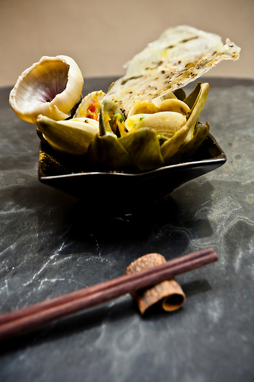 Artichoke from Dalat with nectar clam sauce and Halong Bay curry at Verticale restaurant in Hanoi, Vietnam.