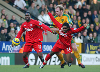 Fotball<br /> Premier League England 2004/2005<br /> Foto: SBI/Digitalsport<br /> NORWAY ONLY<br /> <br /> 03.01.2005<br /> <br /> Norwich City v Liverpool<br /> <br /> Norwich's Gary Doherty holds back Liverpool's Florent Sinama Pongolle while Salif  Diao looks on