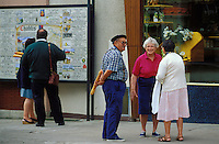 Conversation among old friends in Chablis, Burgundy, France