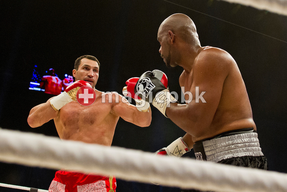 Titleholder Wladimir Klitschko of Ukraine (L) fights contender Tony Thompson of the United States during their world heavyweight championship title fight at the Stade de Suisse soccer stadium in Bern, Switzerland, Saturday, July 7, 2012. (Photo by Patrick B. Kraemer / MAGICPBK)