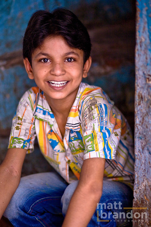 A young boy on the steps of his home in Nizamuddin.