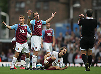 Photo: Lee Earle.<br /> West Ham United v Arsenal. The FA Barclays Premiership. 29/09/2007. West Ham's Lee Bowyer (2ndL) protests to the ref as Arsenal's Mathieu Flamini shows his pain.