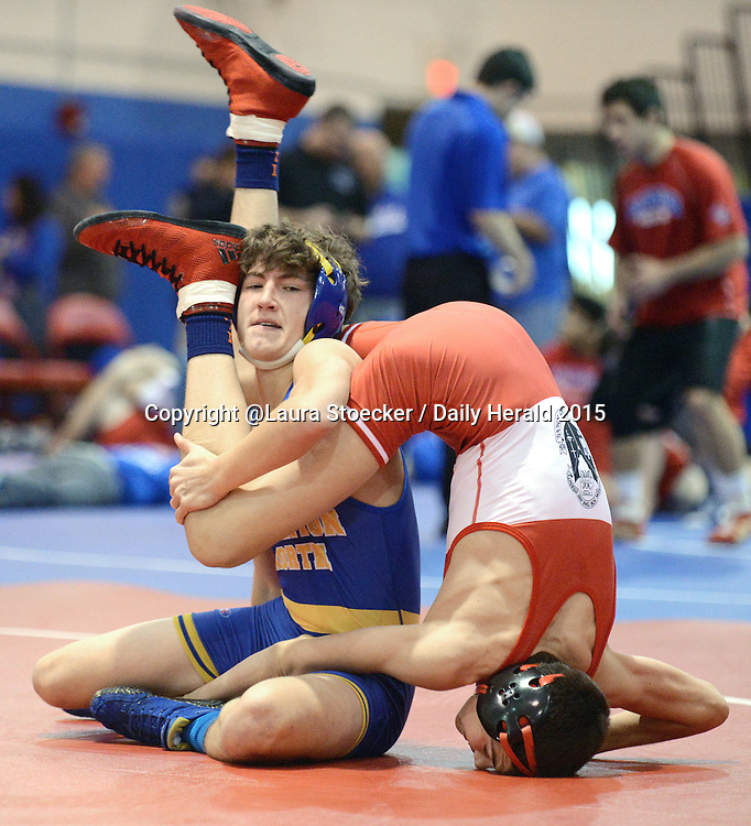 Laura Stoecker/lstoecker@dailyherald.com<br /> Wheaton North's Chase Balosky takes Marist's Jack Feldner in the 113 pound match Aurora Saturday.