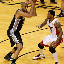 Jun 6, 2013; Miami, FL, USA; San Antonio Spurs power forward Tim Duncan (21) looks to pass defended by Miami Heat power forward Udonis Haslem (40) in the first quarter during game one of the 2013 NBA Finals at the American Airlines Arena. Mandatory Credit: Derick E. Hingle-USA TODAY Sports