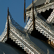 Detail on a Northern Thailand burmese style temple roof in Mae Hong Song, Thailand.